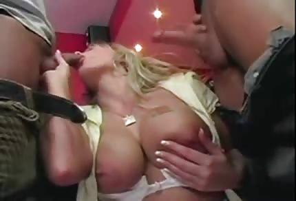 Sucking two big dicks