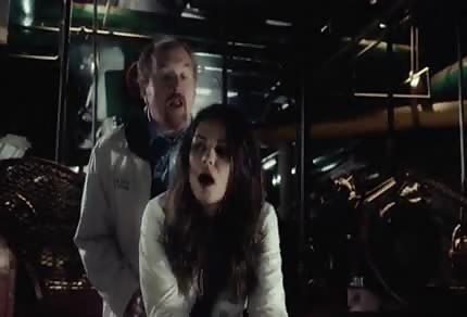 Mila Kunis is being taken from behind