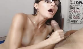 Cute nerdy chick is blowing his cock