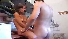 In the kitchen with sexy mommy