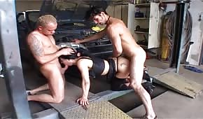 Brunette is fucking with two car mechanics