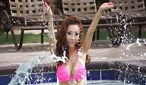 Sexy asian with big tits in bikini