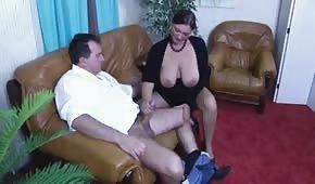 Fat brunette is sucking his dick