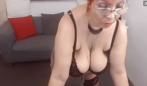 Loose breasts of an old vixen