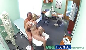 The doctor moves a shapely patient