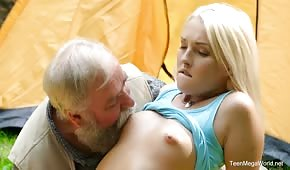 Grandfather playing with blonde in the garden