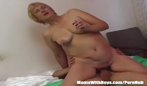 Mature lady writhing on a dick