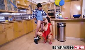 Young milf moves in the kitchen during a family event