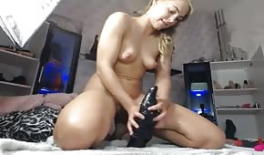 Young chick on a big dildo