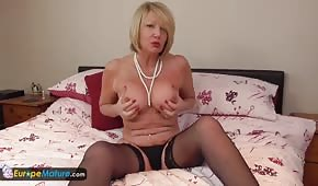 Mom in stockings is playing with boobs and a pipette
