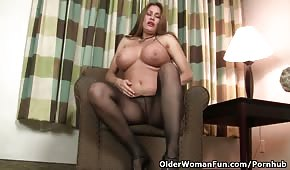 Busty lalu on the armchair