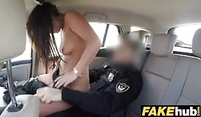 The policeman is moving a nice cane in the car