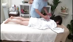 He massaged and smacked Asian
