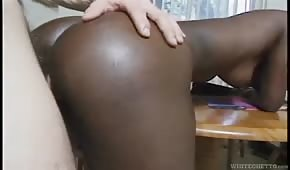 Pale penis in a chocolate ass