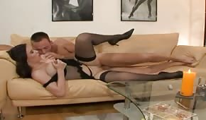 Divine sex with a natural lily on the couch