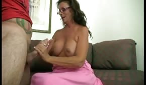 Silicone mom massages the cock with her hand