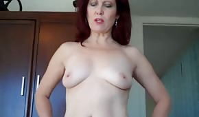 Red-haired mommy rides a dick