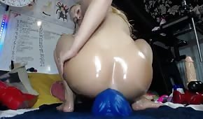 A huge dildo in a blonde asshole