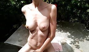 Naked girl is doing well outdoors