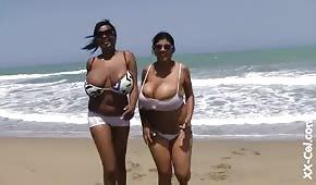 Round black women by the ocean