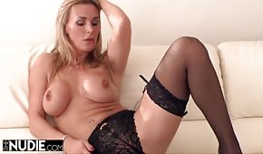 Lalunia in stockings caressed her pussy