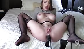 The sex machine is penetrating her ass
