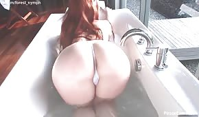 Busty vixen masturbates while bathing