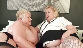 Fat and mature lesbians caress their pips