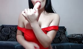 Excited babe sucks a rubber cock