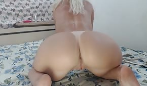 Naked chick sticks out her big ass
