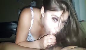 Exotic lady is giving a blowjob in the morning