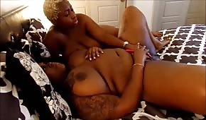 The blonde black woman caressed the body of a round chick