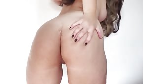 The chick pats her big buttocks