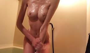 Wet babe masturbates in the bathroom