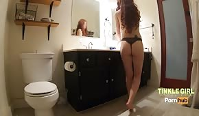 Red-haired young lady in the bathroom