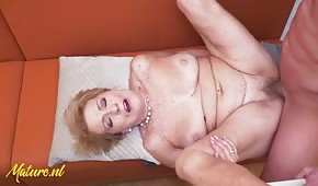 Good sex with a mature blonde on the table