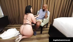The fat cupcake falls on her knees in front of the black man