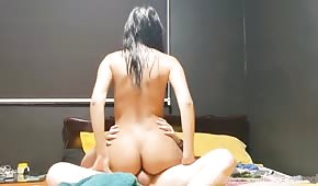 Naked maid squirming on a dick
