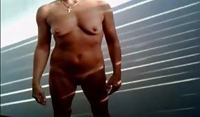 Naked amateur masturbates on a stand