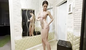 Oiled body of a silicone brunette