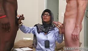 A shy Arab woman whips two cocks
